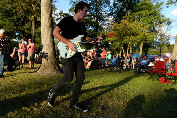 Paul Childers leaves the stage to perform among the crowd during Oktoberfest at Beaumont's Rogers Park on Saturday.  Photo taken Saturday 10/21/17 Ryan Pelham/The Enterprise