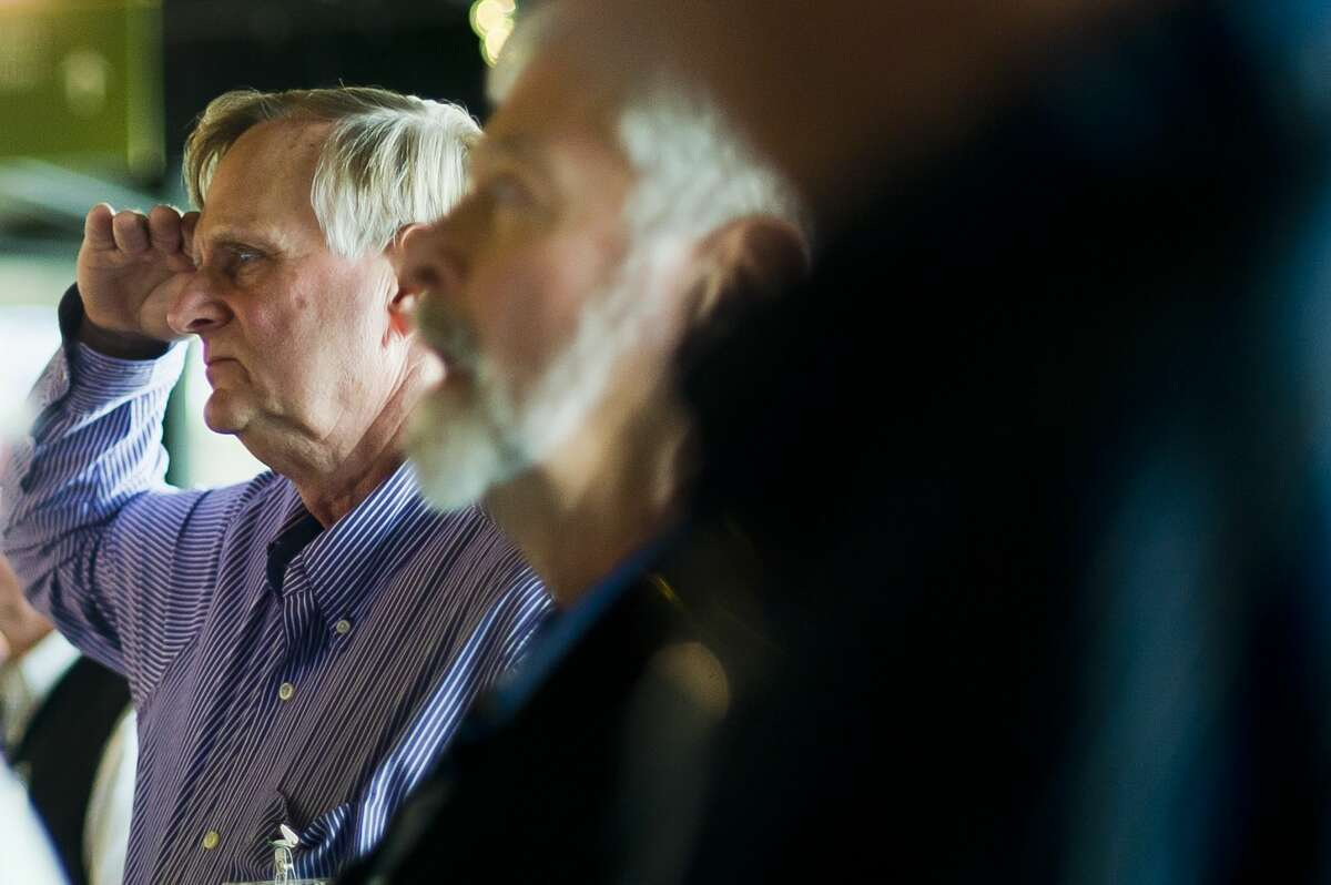 A graduate of the Midland High School class of 1967 holds a salute as the Pledge of Allegiance is recited during their 50th reunion on Saturday, Oct. 21, 2017 at Dow Diamond. (Katy Kildee/kkildee@mdn.net)