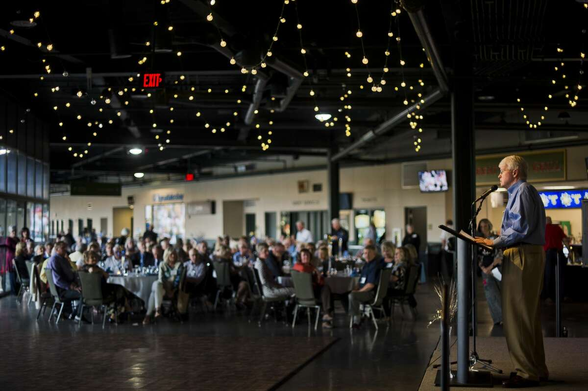A graduate in the Midland High School class of 1967 speaks during their 50th reunion on Saturday, Oct. 21, 2017 at Dow Diamond. (Katy Kildee/kkildee@mdn.net)