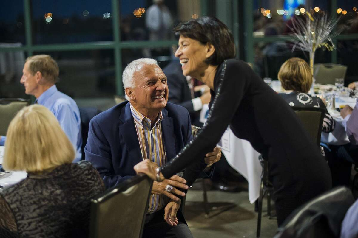 Terry Collins, manager of the New York Mets and a graduate of the Midland High School class of 1967, left, chats with former classmate Joanne Hauri Smith during their 50th high school reunion on Saturday, Oct. 21, 2017 at Dow Diamond. (Katy Kildee/kkildee@mdn.net)