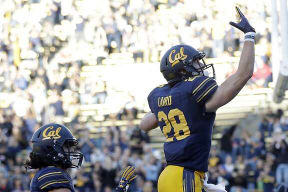 California running back Patrick Laird (28) celebrates after scoring on a rushing touchdown against Arizona during the first half of an NCAA college football game Saturday, Oct. 21, 2017, in Berkeley, Calif. (AP Photo/Marcio Jose Sanchez)