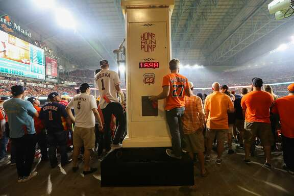Fans try to get a good look at the action during the ALCS Game 7 Saturday, Oct. 21, 2017, in Houston. ( Steve Gonzales / Houston Chronicle )