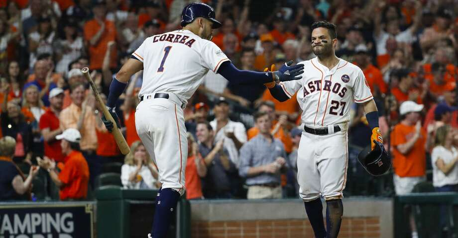 Houston Astros second baseman Jose Altuve (27) and shortstop Carlos Correa (1) celebrate Altuve's solo home run in the fifth inning of Game 7 of the ALCS at Minute Maid Park, Satuday, Oct. 21, 2017, in Houston. ( Karen Warren / Houston Chronicle ) Photo: Karen Warren/Houston Chronicle