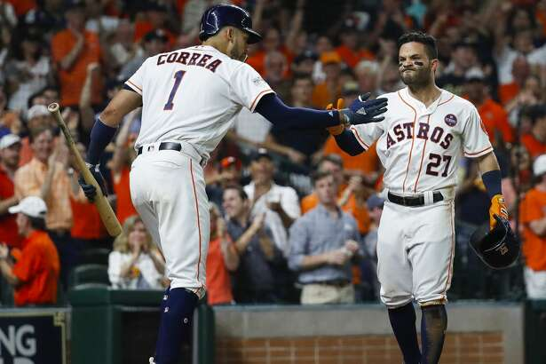 Houston Astros second baseman Jose Altuve (27) and shortstop Carlos Correa (1) celebrate Altuve's solo home run in the fifth inning of Game 7 of the ALCS at Minute Maid Park, Satuday, Oct. 21, 2017, in Houston. ( Karen Warren / Houston Chronicle )