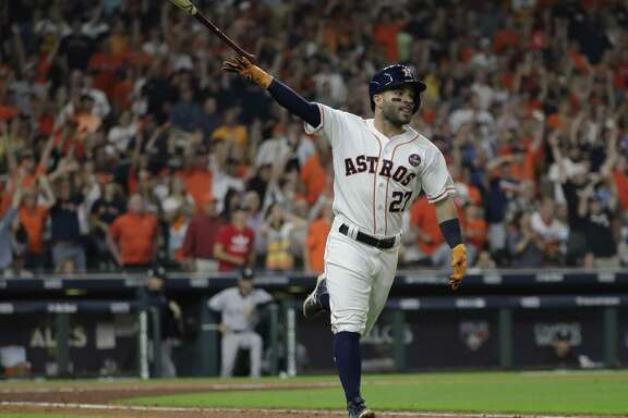The Astros' Jose Altuve celebrates after hitting a home run during the fifth inning of Game 7 at Minute Maid Park.