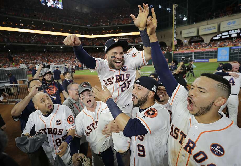 Houston Astros' Jose Altuve is lifted by teammates after Game 7 of baseball's American League Championship Series against the New York Yankees Saturday, Oct. 21, 2017, in Houston. The Astros won 4-0 to win the series. (AP Photo/David J. Phillip) Photo: David J. Phillip, Associated Press