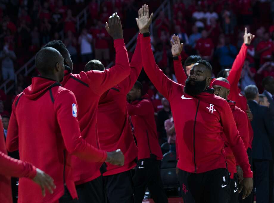 Houston Rockets guard James Harden (13) high-fives his teammates before the start of the game against the Dallas Mavericks, Saturday, Oct. 21, 2017, in Houston. ( Marie D. De Jesus / Houston Chronicle ) Photo: Marie D. De Jesus/Houston Chronicle