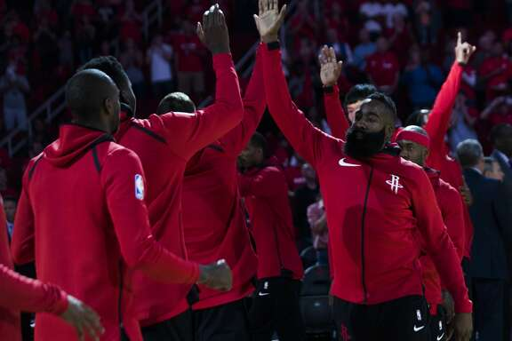 Houston Rockets guard James Harden (13) high-fives his teammates before the start of the game against the Dallas Mavericks, Saturday, Oct. 21, 2017, in Houston. ( Marie D. De Jesus / Houston Chronicle )