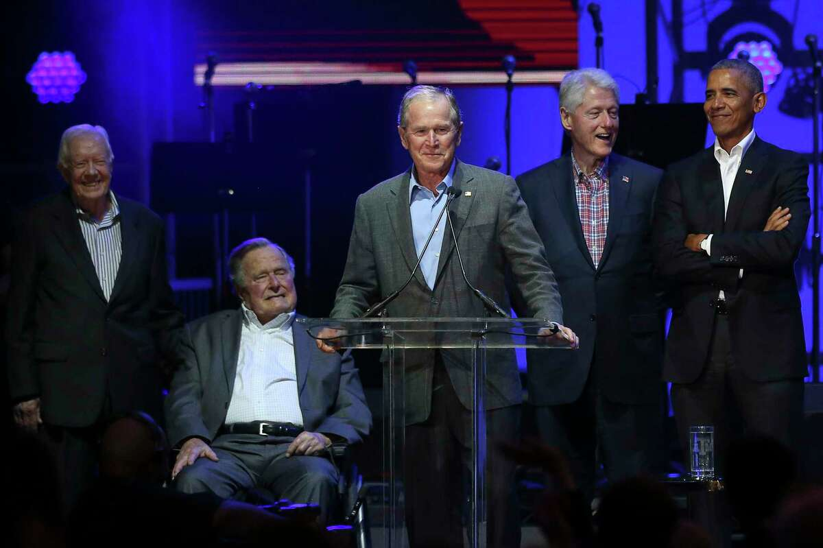 Former President George W. Bush speaks at a benefit concert for the One America Appeal. He was joined by, from left, former Presidents Jimmy Carter, George H.W. Bush, Bill Clinton and Barack Obama.