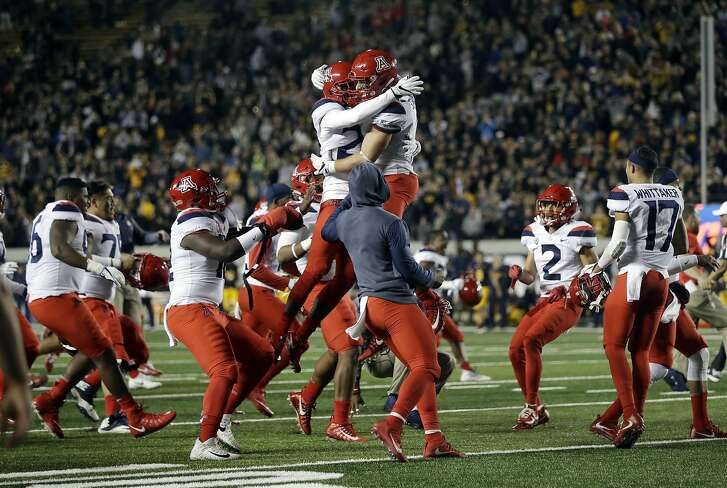 Arizona players celebrate after a failed 2-point conversion gave them a 45-44 win over California in two overtimes during an NCAA college football game Saturday, Oct. 21, 2017, in Berkeley, Calif. (AP Photo/Marcio Jose Sanchez)