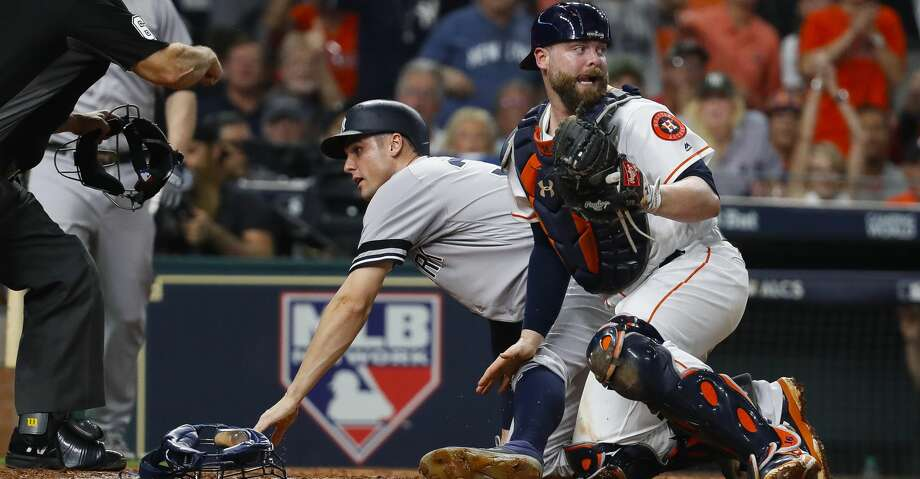 New York Yankees first baseman Greg Bird (33) is called out from the Houston Astros catcher Brian McCann (16) tag during the fifth inning of Game 7 of the ALCS at Minute Maid Park, Satuday, Oct. 21, 2017, in Houston. ( Karen Warren / Houston Chronicle ) Photo: Karen Warren/Houston Chronicle