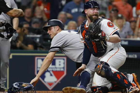 New York Yankees first baseman Greg Bird (33) is called out from the Houston Astros catcher Brian McCann (16) tag during the fifth inning of Game 7 of the ALCS at Minute Maid Park, Satuday, Oct. 21, 2017, in Houston. ( Karen Warren / Houston Chronicle )