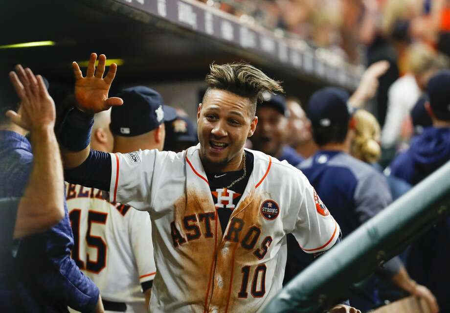 Houston Astros first baseman Yuli Gurriel (10) celebrates in the dugout after he and shortstop Carlos Correa (1) were driven home by a Brian McCann double in the fifth inning of Game 7 of the ALCS at Minute Maid Park, Satuday, Oct. 21, 2017, in Houston. ( Karen Warren / Houston Chronicle ) Photo: Karen Warren/Houston Chronicle