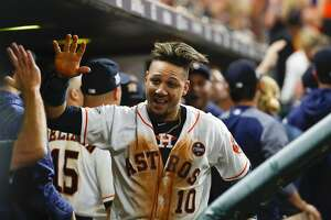 Houston Astros first baseman Yuli Gurriel (10) celebrates in the dugout after he and shortstop Carlos Correa (1) were driven home by a Brian McCann double in the fifth inning of Game 7 of the ALCS at Minute Maid Park, Satuday, Oct. 21, 2017, in Houston. ( Karen Warren / Houston Chronicle )
