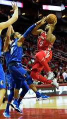 Rockets guard Eric Gordon (10) drives toward the basket on his way to scoring 18 points in 24 minutes against the Mavericks at Toyota Center.