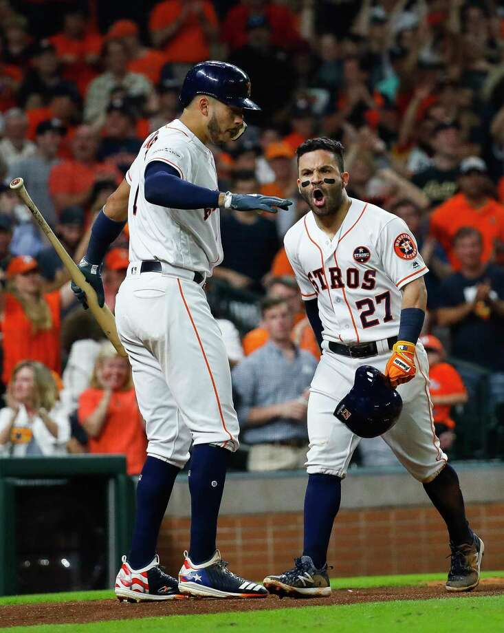 Astros second baseman Jose Altuve, right, and shortstop Carlos Correa celebrate Altuve's solo home run in the fifth inning of Saturday night's ALCS-clinching win over the Yankees at Minute Maid Park. Photo: Karen Warren, Houston Chronicle / @ 2017 Houston Chronicle