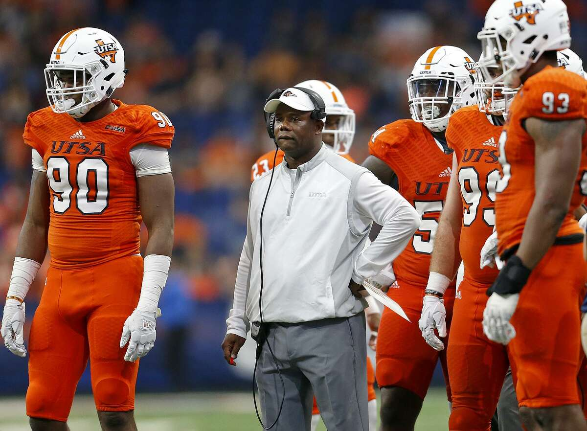 UTSA Roadrunners head coach Frank Wilson (center) stands with players during a timeout in second half action against the Rice Owls Saturday Oct. 21, 2017 at the Alamodome. The UTSA Roadrunners won 20-7.