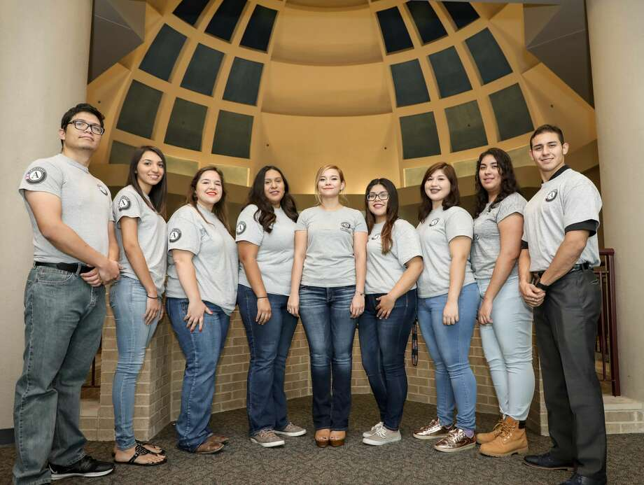 TAMIU AmeriCorps members provided assistance to victims of Hurricane Harvey by operating a bilingual phone bank. Members Angel Vazquez, Luz Gonzalez, Kazandra Sandoval, Ashley Hernandez, Jesenia Lozano, Yesenia Padilla, Lucero Gallegos, Alba Hernandez and Osvaldo Guzman are pictured. Not pictured are Sonia Herrera, Fabby Olguin and Victoria Beltran. Photo: Courtesy