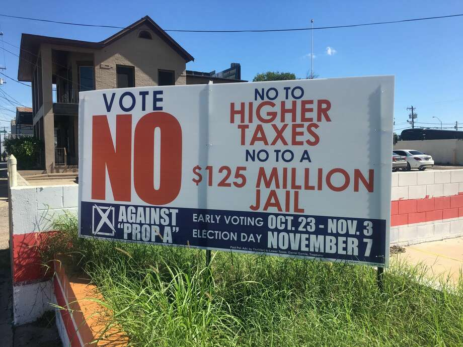 A sign opposing the proposed Webb County law enforcement facility is perched on Victoria Street. Photo: Julia Wallace/Laredo Morning Times