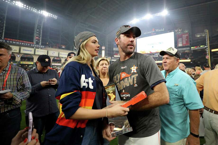 Kate Upton on the field after the Astros game 7 ALCS championship victory against the Yankees Photo: Ronald Martinez, Getty Images / 2017 Getty Images