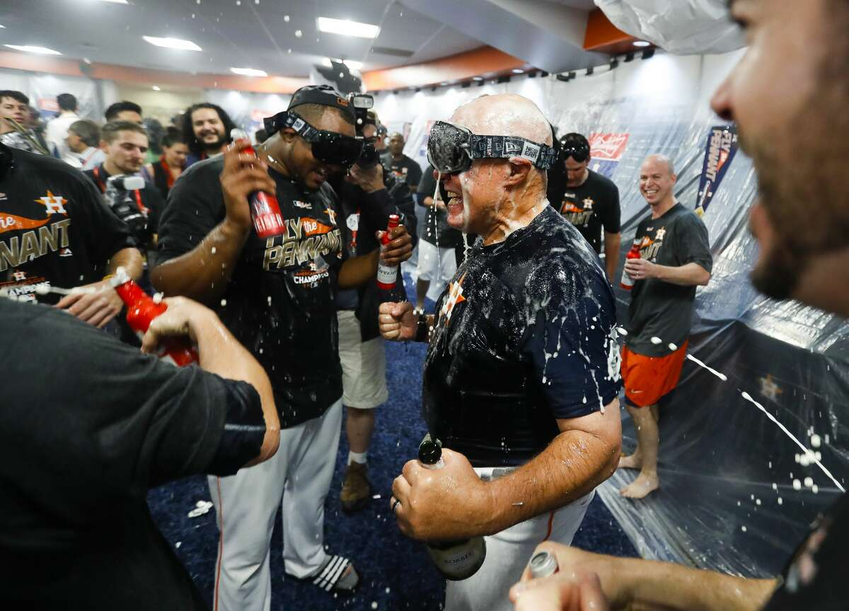 Astros pitching coach Brent Strom celebrates the Astros 4-0 win over the Yankees in Game 7 of the ALCS at Minute Maid Park, Satuday, Oct. 21, 2017, in Houston.