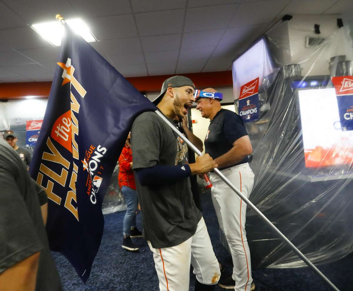 Houston Astros shortstop Carlos Correa (1) celebrates in the locker room after the Astros 4-0 win over the Yankees in Game 7 of the ALCS at Minute Maid Park, Satuday, Oct. 21, 2017, in Houston.