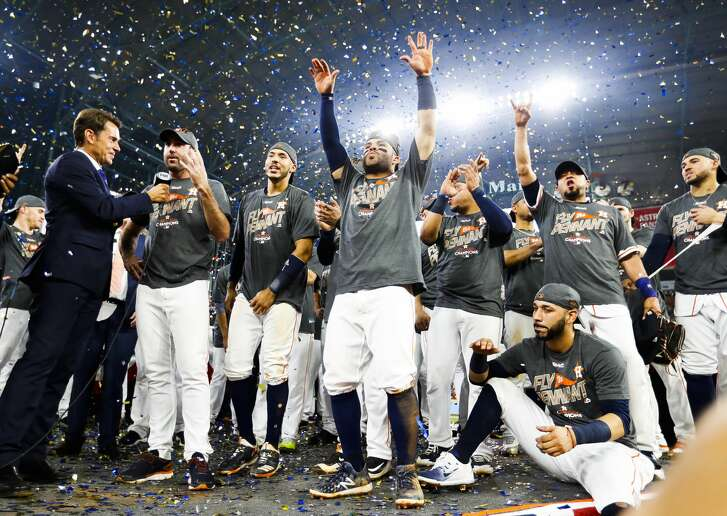 The Astros celebrate their 4-0 win over the Yankees in Game 7 of the ALCS at Minute Maid Park, Satuday, Oct. 21, 2017, in Houston.