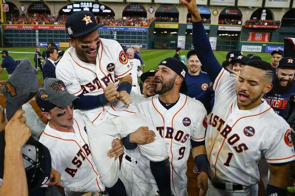 Alex Bregman and Marwin Gonzalez hold Jose Altuve on their shoulders while celebrating the Astros 4-0 win over the Yankees in Game 7 of the ALCS at Minute Maid Park on Saturday, Oct. 21, 2017, in Houston.