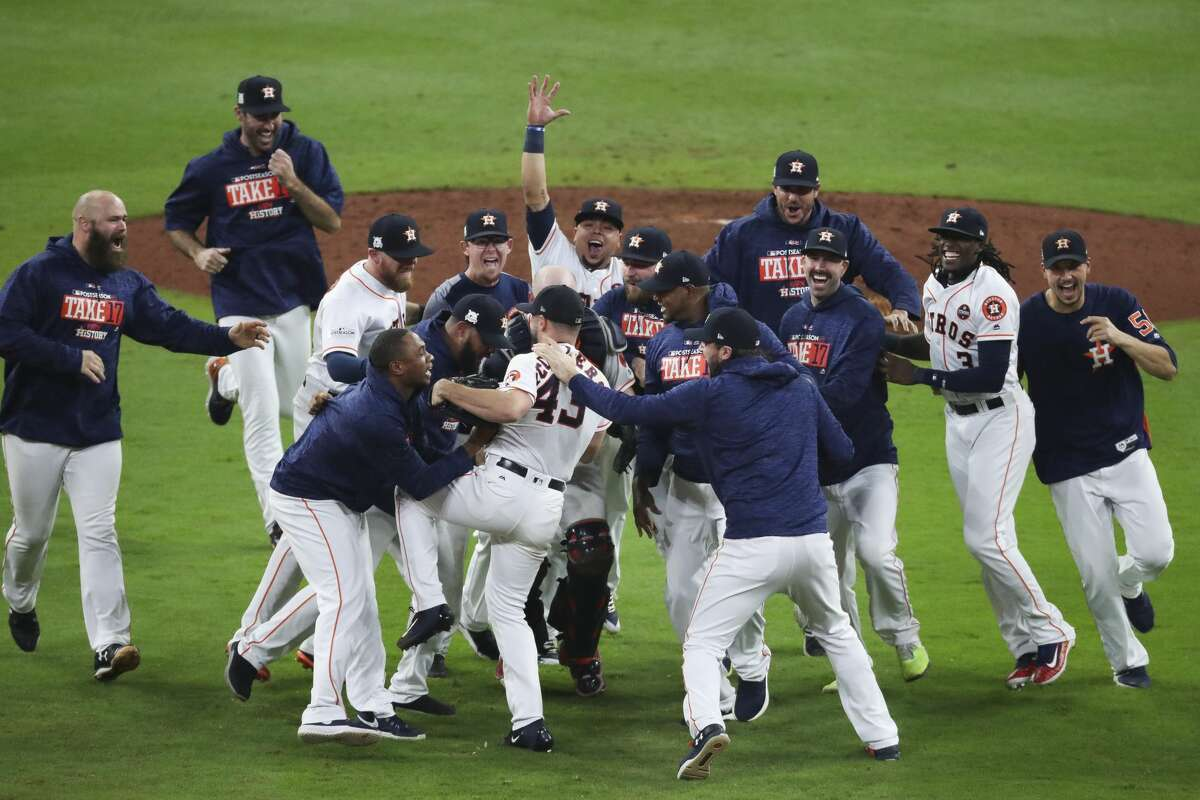 The Houston Astros celebrate as they beat the New York Yankees 4-0 in Game 7 of the ALCS to head to the World Series at Minute Maid Park Saturday, Oct. 21, 2017 in Houston.