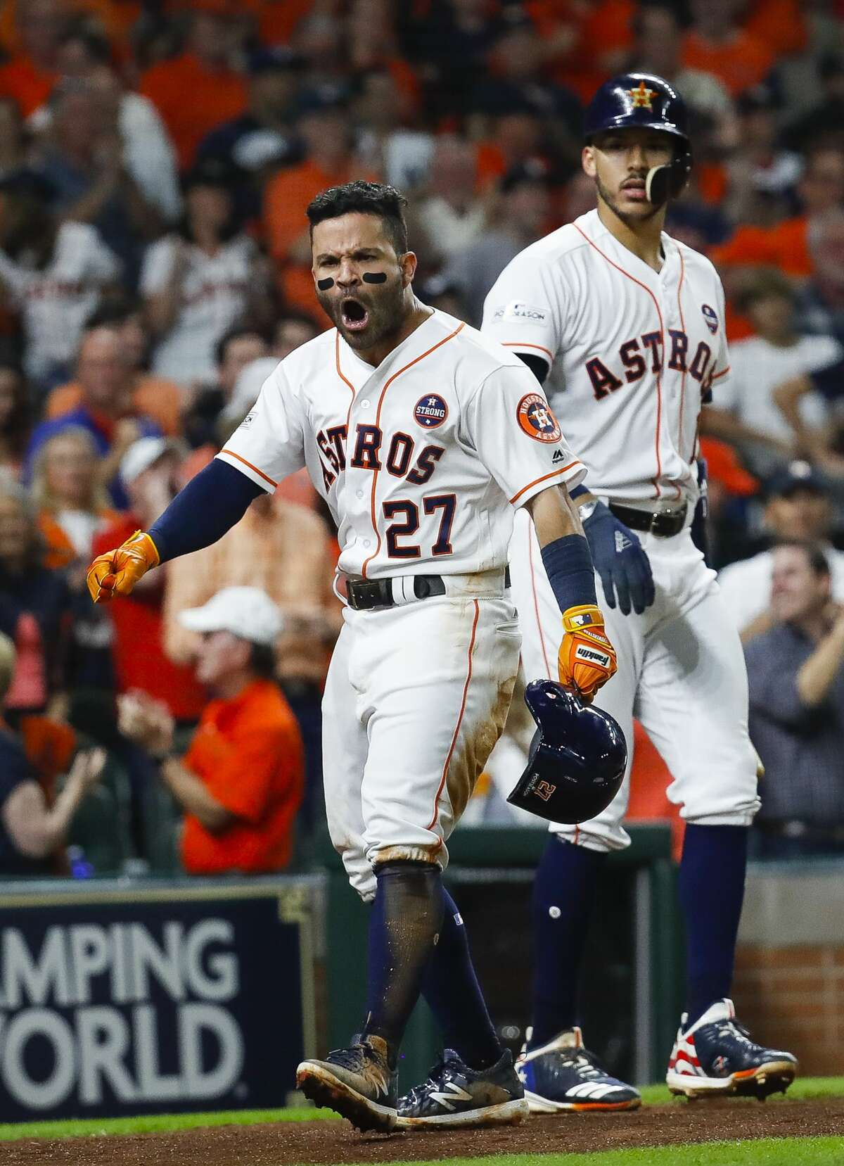 Houston Astros second baseman Jose Altuve (27) and shortstop Carlos Correa (1) celebrate Altuve's solo home run in the fifth inning of Game 7 of the ALCS at Minute Maid Park, Satuday, Oct. 21, 2017, in Houston.