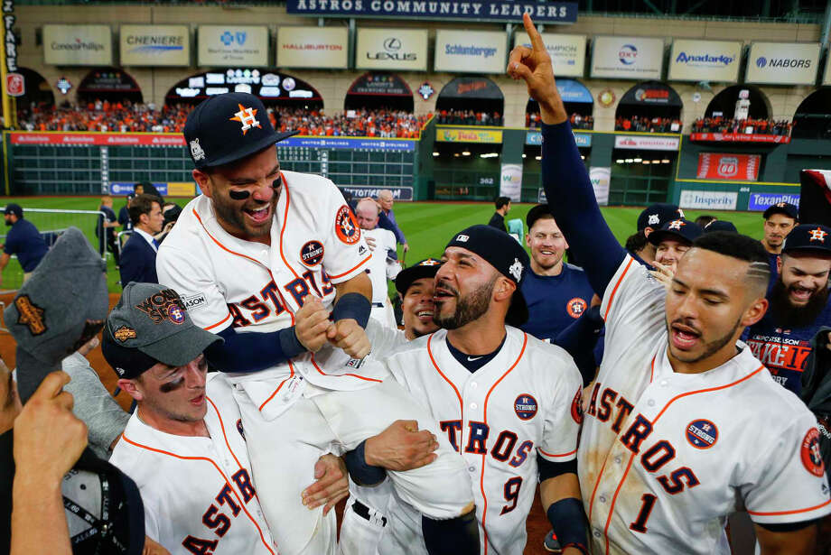 Alex Bregman, Altuve, Marwin Gonzales and Carlos Correa celebrate after the Astros defeated the Yankees to advance to the World Series. / © 2017 Houston Chronicle