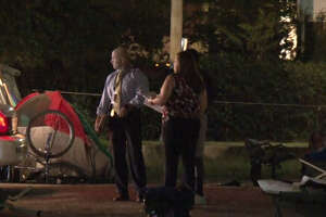 A man was shot to death Sunday morning in a homeless encampment.