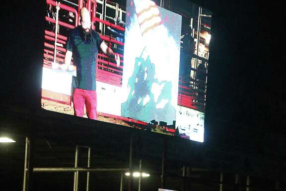 Joe Everson, a self-acclaimed renaissance man as artist, vocalist, musician and photographer, receives applause from the grateful crowd Saturday night at the Trinity Valley Exposition Rodeo. Everson belted out the difficult to sing national anthem and simultaneously painted the iconic scene of the American flag being raised after the Battle of Iwo Jima during World War II.