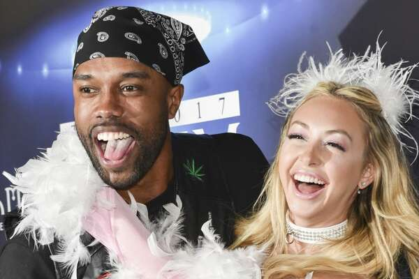 LOS ANGELES, CA - OCTOBER 21:  DeMario Jackson and Corinne Olympios arrive at the 2017 MAXIM Halloween Party at LA Center Studios on October 21, 2017 in Los Angeles, California.  (Photo by Rodin Eckenroth/Getty Images for MAXIM)