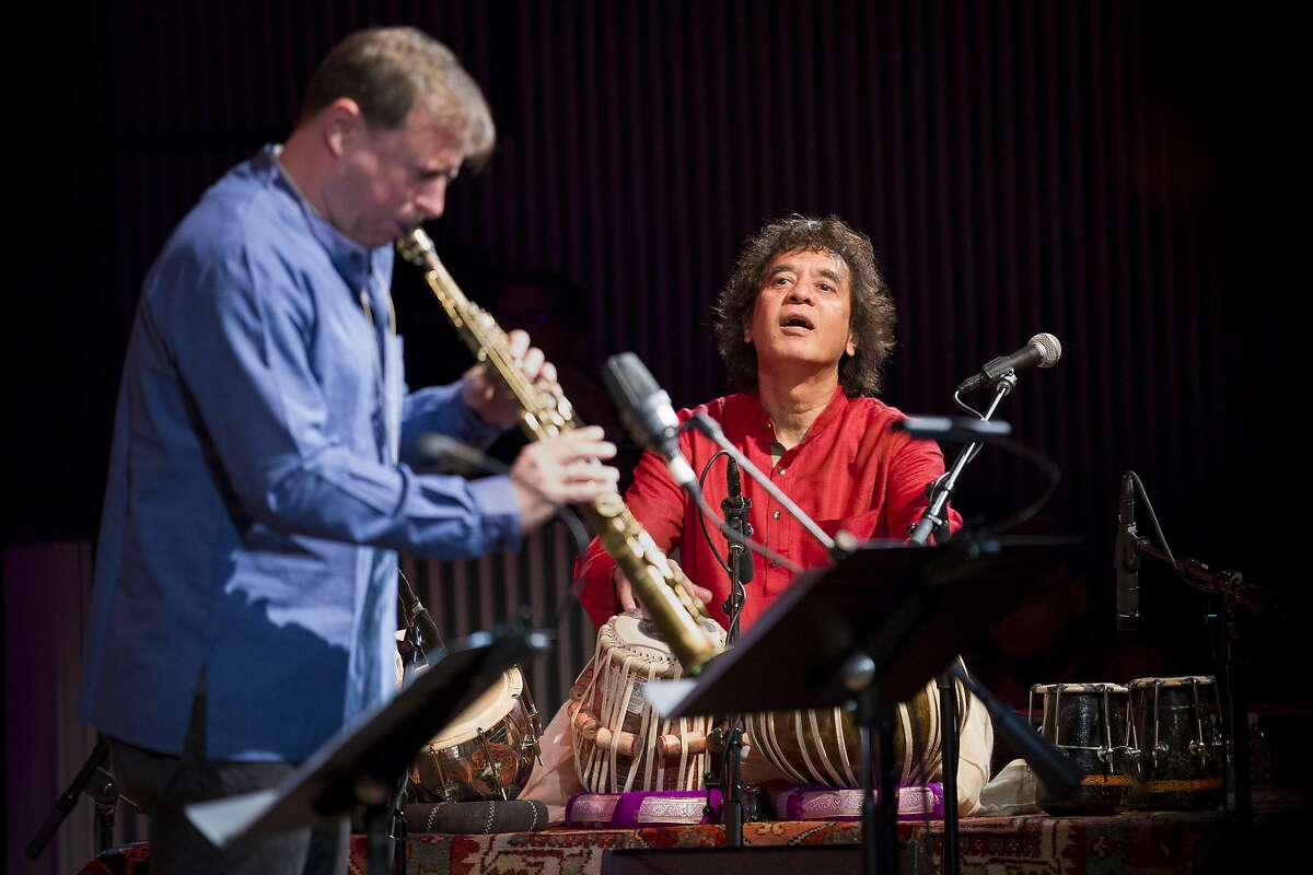 From left: Chris Potter and Zakir Hussain perform during the Crosscurrents concert at the SFJAZZ Center on Saturday, Oct. 21, 2017, in San Francisco, Calif.