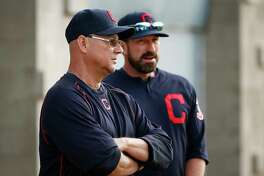 Cleveland Indians manager Terry Francona, left, and pitching coach Mickey Callaway talk before practice starts at the Indians baseball spring training facility Tuesday, Feb. 14, 2017, in Goodyear, Ariz. (AP Photo/Ross D. Franklin)