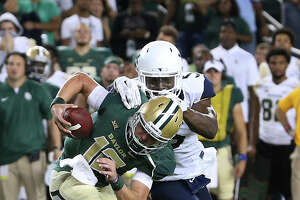 Baylor quarterback Charlie Brewer (12) is is sacked in the final minutes of the NCAA college football game by West Virginia linebacker Xavier Preston (5), Saturday, Oct. 21, 2017, in Waco, Texas. West Virginia won 38-36. (AP Photo/Jerry Larson)