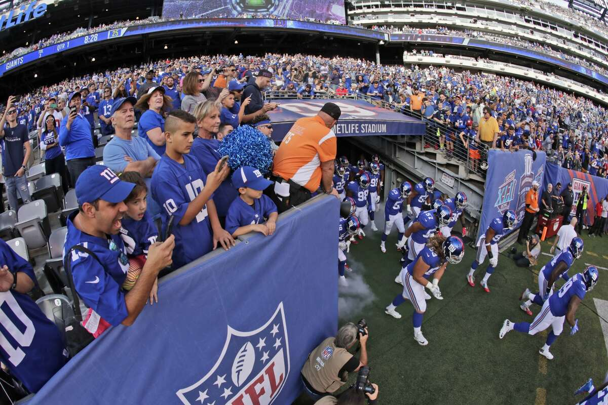 New York Giants take the field before an NFL football game against the Seattle Seahawks, Sunday, Oct. 22, 2017, in East Rutherford, N.J. (AP Photo/Julio Cortez)