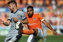Houston Dynamo defender Leonardo (22) gets the ball away from Chicago Fire forward Luis Solignac (9) while defensing during the first half of the last MLS regular game at BBVA Compass Stadiujm on Sunday, Oct. 22, 2017, in Houston.