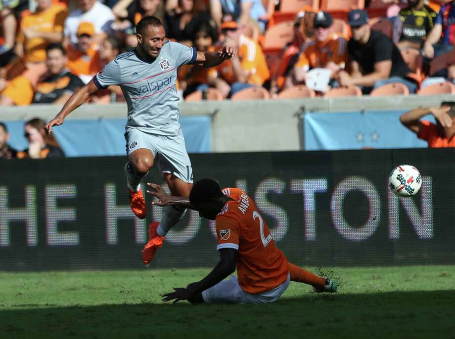 Chicago Fire forward Arturo Alvarez (12) leaps over Houston Dynamo defender Jalil Anibaba (2) while carrying the ball toward the box as Anibaba is trying to get the ball away from him during the first half of the last MLS regular game at BBVA Compass Stadiujm on Sunday, Oct. 22, 2017, in Houston. Photo: Yi-Chin Lee, Houston Chronicle / © 2017  Houston Chronicle