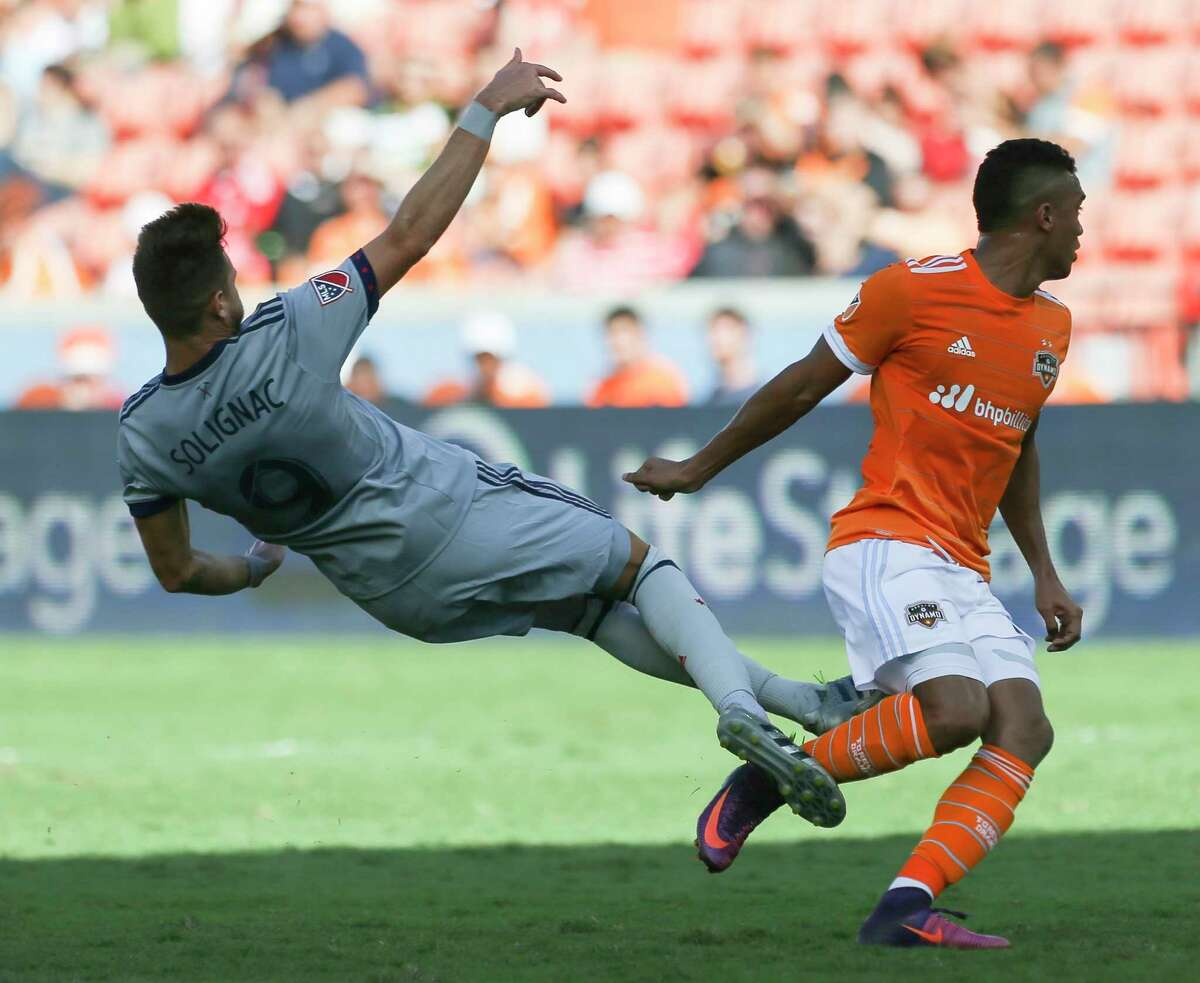 Houston Dynamo forward Mauro Manotas (19) pushes Chicago Fire forward Luis Solignac (9) away while defensing during the first half of the last MLS regular game at BBVA Compass Stadiujm on Sunday, Oct. 22, 2017, in Houston.