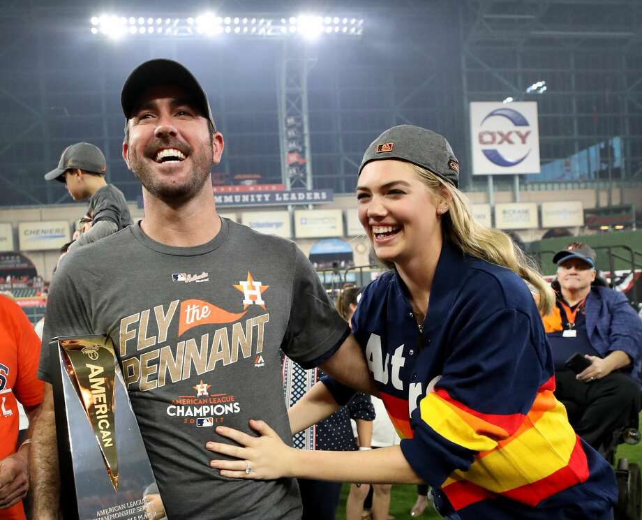 HOUSTON, TX - OCTOBER 21:  Justin Verlander #35 of the Houston Astros celebrates with model Kate Upton and the MVP trophy after defeating the New York Yankees by a score of 4-0 to win Game Seven of the American League Championship Series at Minute Maid Park on October 21, 2017 in Houston, Texas. The Houston Astros advance to face the Los Angeles Dodgers in the World Series.  (Photo by Ronald Martinez/Getty Images) Photo: Ronald Martinez/Getty Images