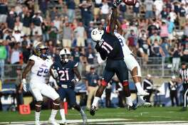 UConn linebacker Junior Joseph (11) breaks up a pass attempt in the end zone to Tulsa wide receiver Keenen Johnson on the final play on Sunday.
