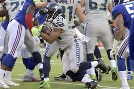 Seattle Seahawks' Thomas Rawls runs the ball during the first half of an NFL football game against the New York Giants, Sunday, Oct. 22, 2017, in East Rutherford, N.J. (AP Photo/Bill Kostroun)