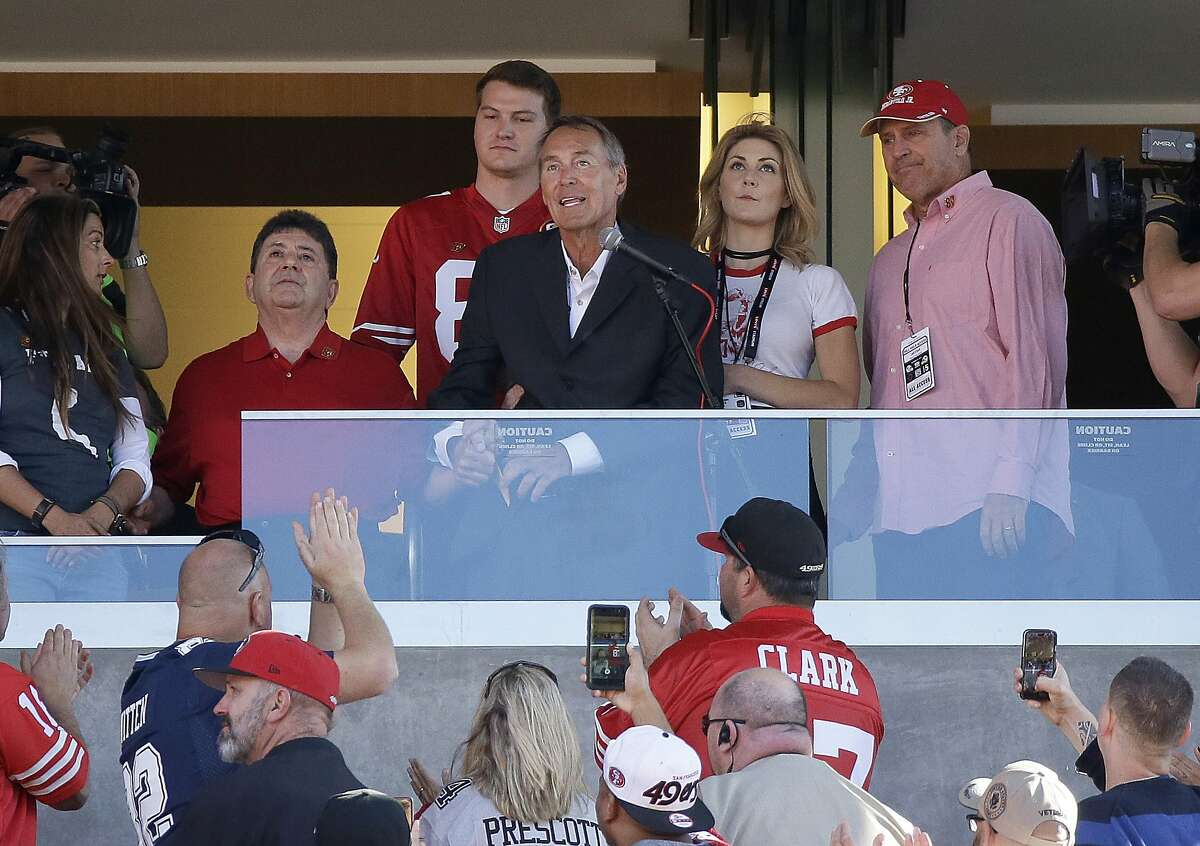 Former wide receiver Dwight Clark, center, speaks next to former San Francisco 49ers owner Edward DeBartolo Jr., left, during halftime of an NFL football game between the 49ers and the Dallas Cowboys in Santa Clara on Sunday, Oct. 22, 2017.