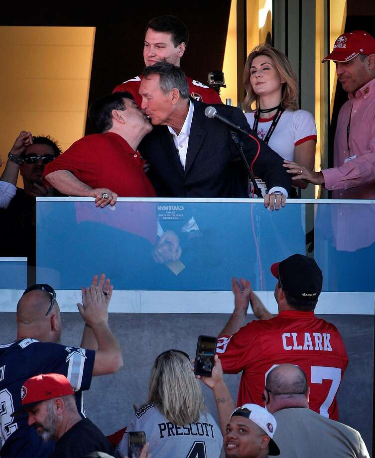 Dwight Clark leans in to kiss Eddie DeBartolo on the cheek during a halftime ceremony honoring the former 49ers receiver, who is battling ALS. Photo: Carlos Avila Gonzalez, The Chronicle