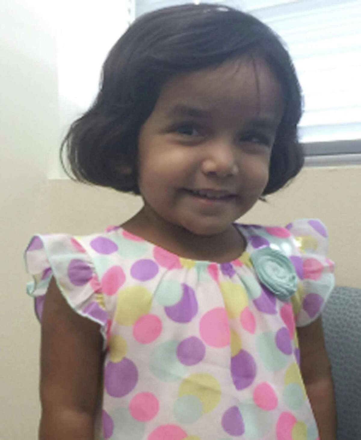 FILE- This undated photo provided by the Richardson Texas Police Department shows 3-year-old Sherin Mathews. Police in a Dallas suburb say they've found the body of a small child on Sunday, Oct. 22, 2017, not far from the home of Sherin Mathews, who's been missing since early this month. Her father, Wesley Mathews, has told authorities he ordered the child to stand next to a tree behind the fence at their home around 3 a.m. on Oct. 7 as punishment for not drinking her milk and she went missing. Police say the body hasn't been positively identified. (Richardson Texas Police Department via AP)