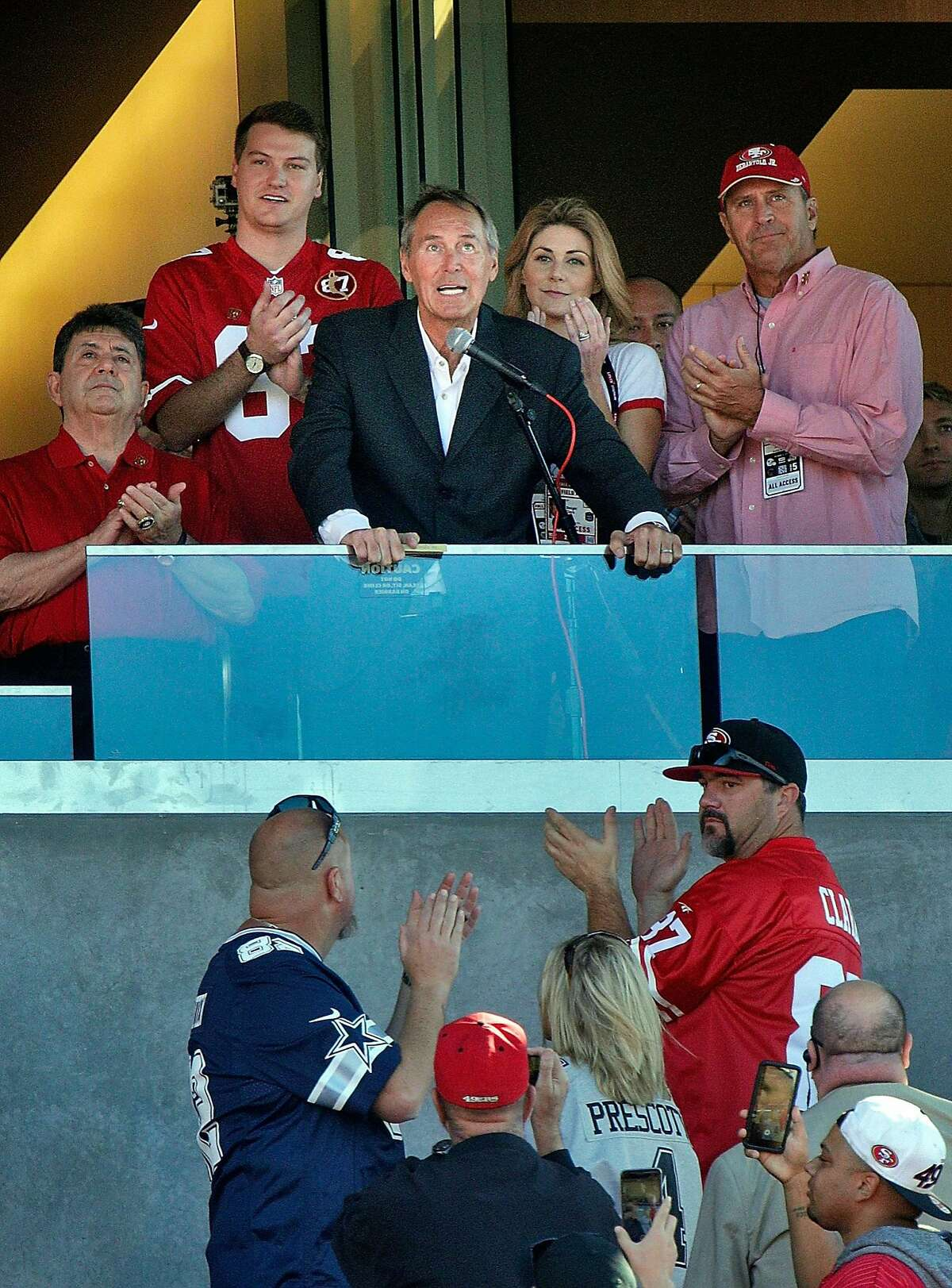 Dwight Clark, flanked by family and Eddieo DeBartolo, speaks to the crowd during a halftime ceremony honoring Clark who recently announced he is battling ALS, as the San Francisco 49ers payed the Dallas Cowboys at Levi's Stadium in Santa Clara on Sunday, Oct. 22, 2017.