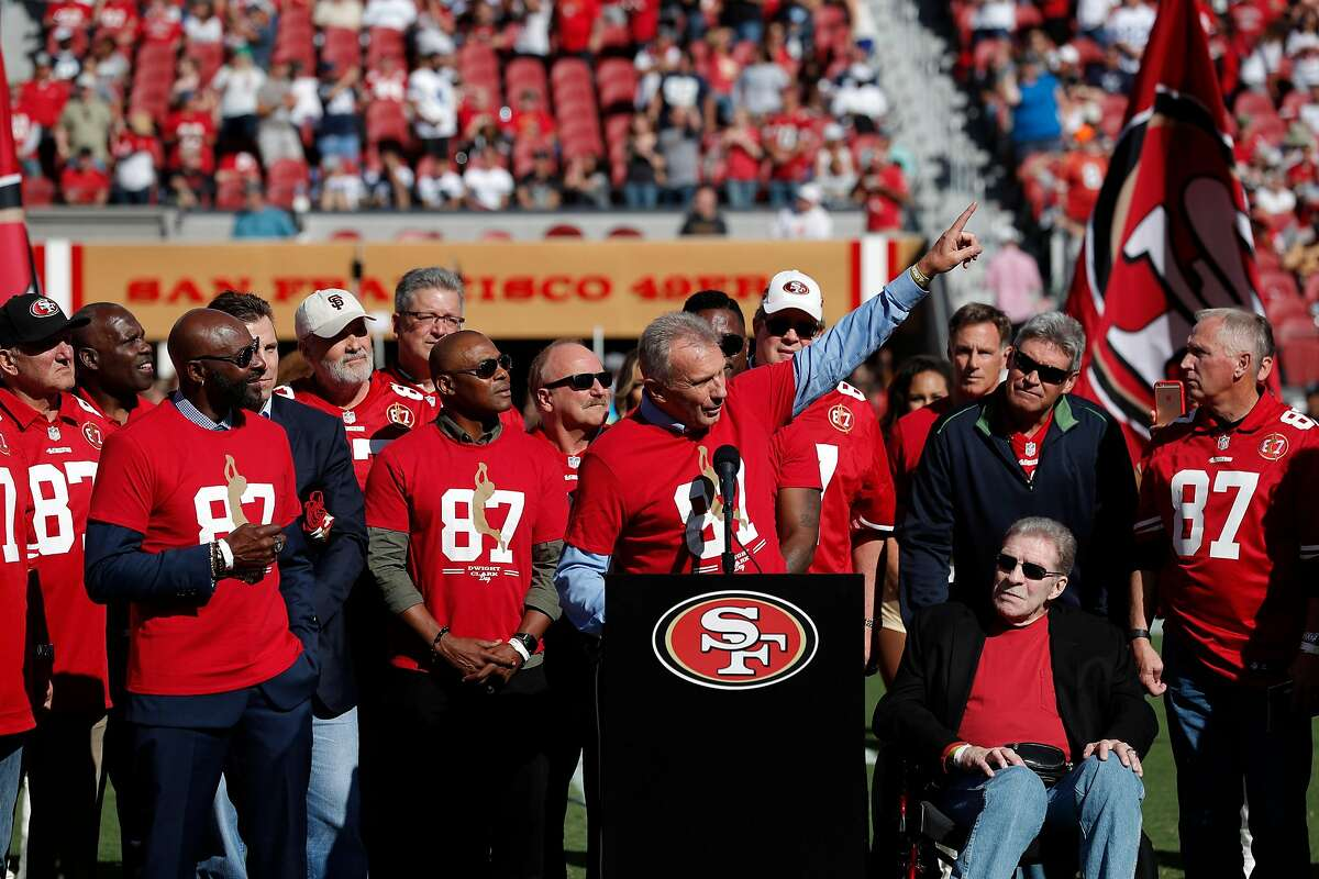 Joe Montana points to his friend and Super Bowl teammate Dwight Clark during a halftime ceremony honoring Clark who recently announced he is battling ALS, as the San Francisco 49ers payed the Dallas Cowboys at Levi's Stadium in Santa Clara on Sunday, October 22, 2017.