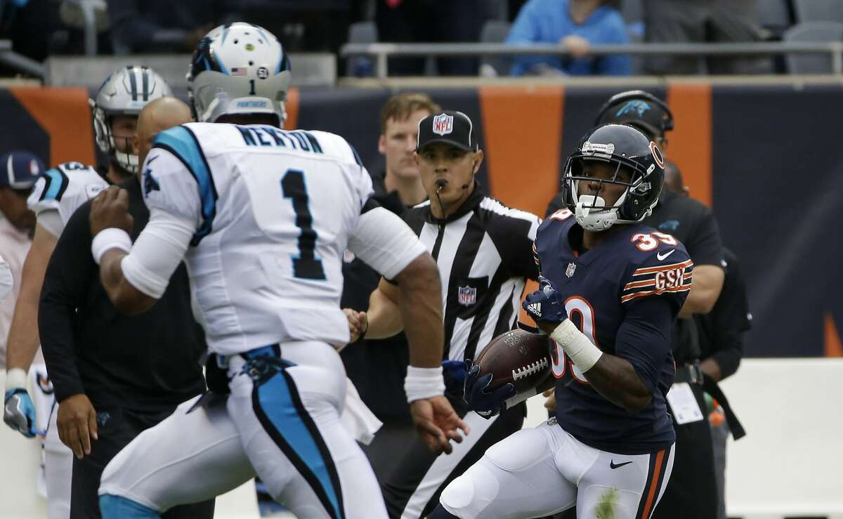 Chicago Bears free safety Eddie Jackson (39) returns an interception thrown by Carolina Panthers quarterback Cam Newton (1) for a 76-yard touchdown during the first half of an NFL football game, Sunday, Oct. 22, 2017, in Chicago. (AP Photo/Nam Y. Huh)